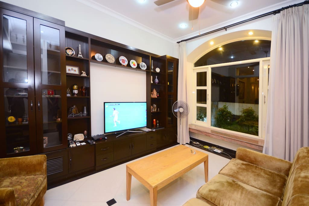 Living room at night time with comfortable couch and TV