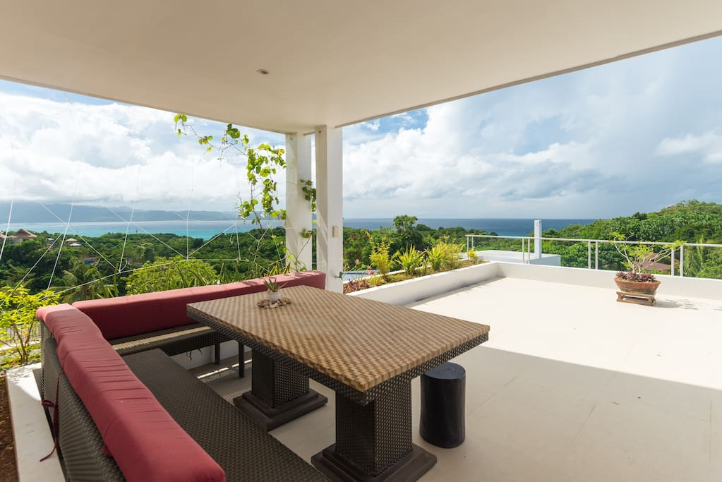 Southwest sea view from private terrace, with dining area.