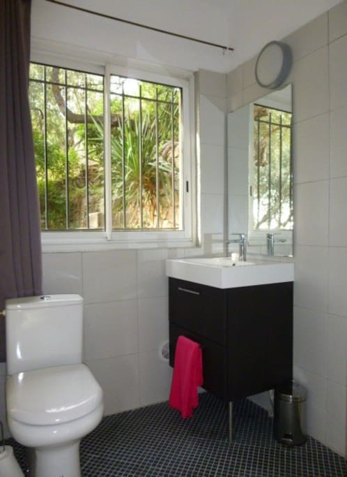 the bathroom is newly refurbished, cabinet, towels at disposal