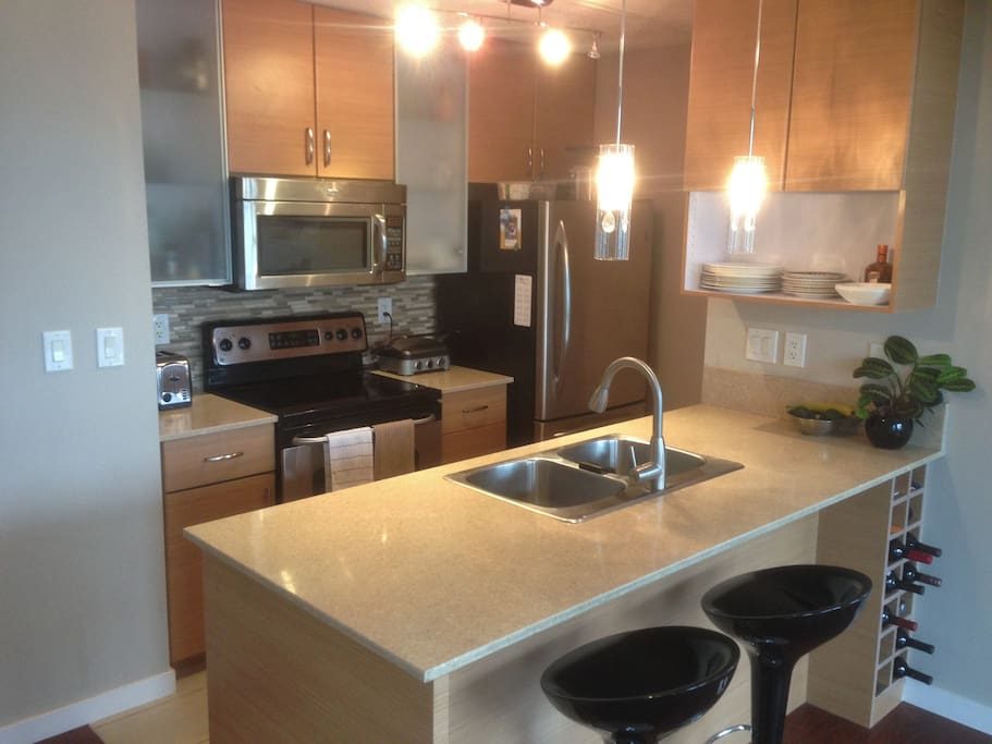 Granite kitchen counters with all utensils pots and pans included
