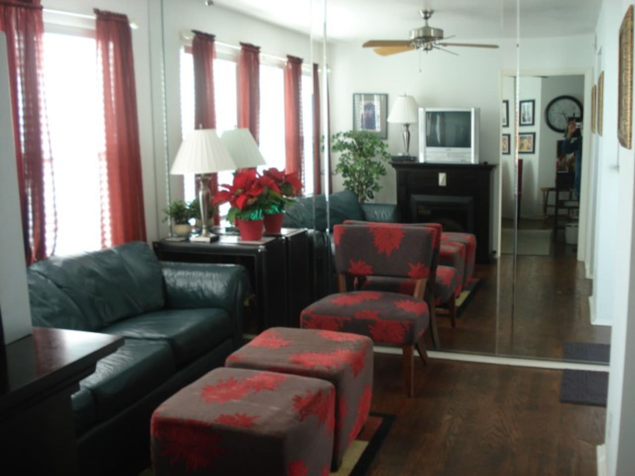 Living room with mirrored wall and windows with nice views overseeing both 34th & Speedway Sts