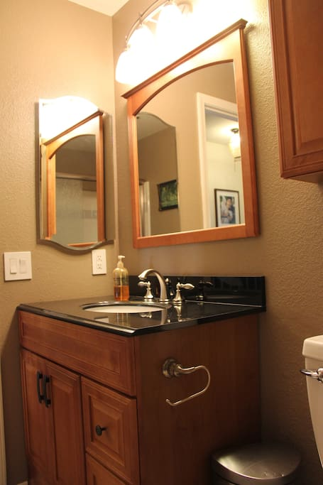 The bathroom - newly remodeled full bathroom, granite countertop, shower and tub.