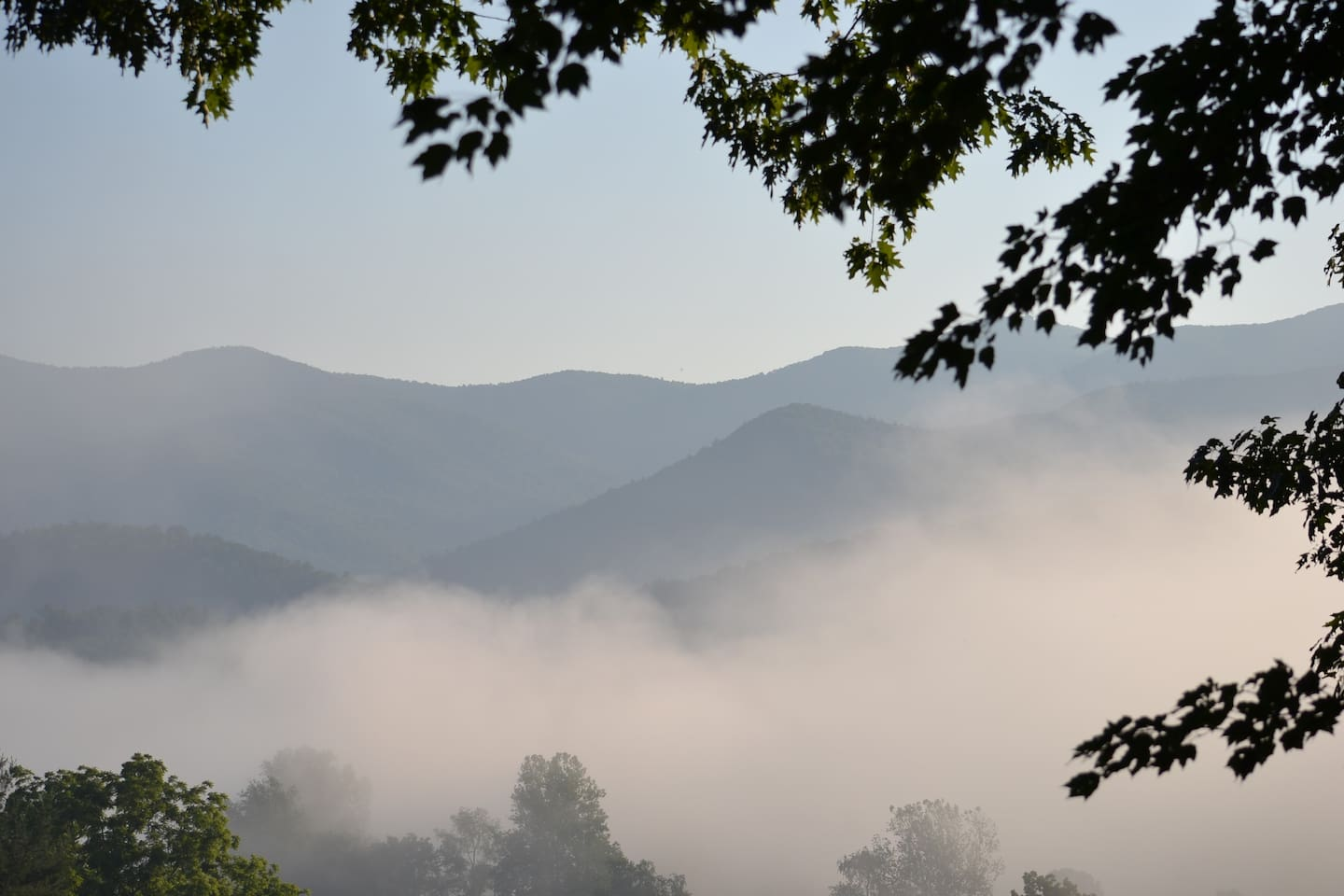 A view from our deck as fog rolls off the mountains