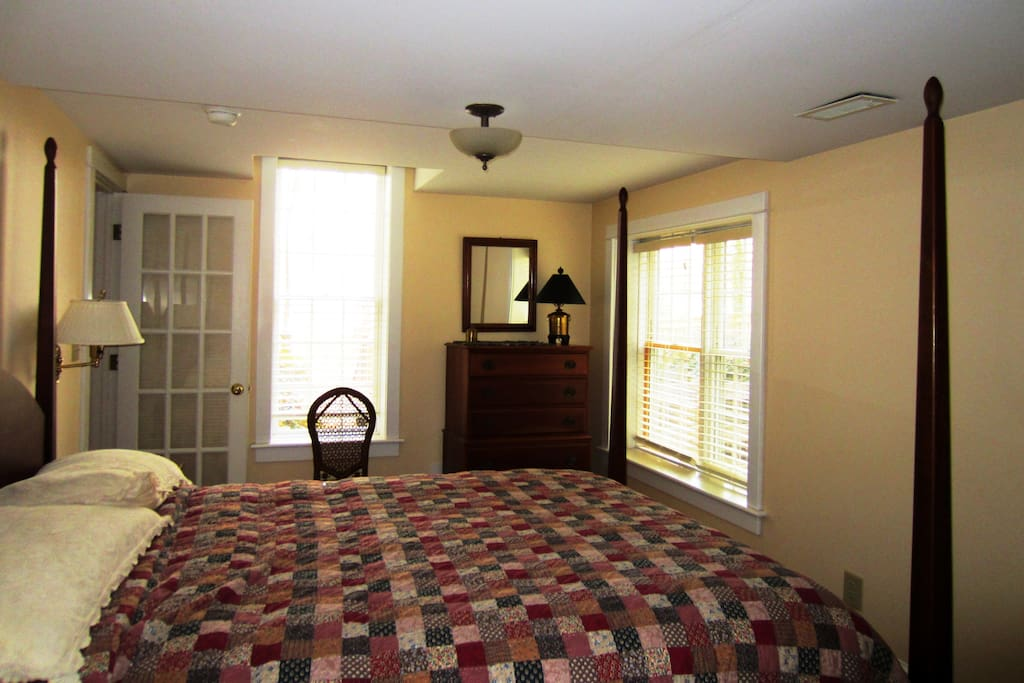 Bedroom one with queen bed and writing desk