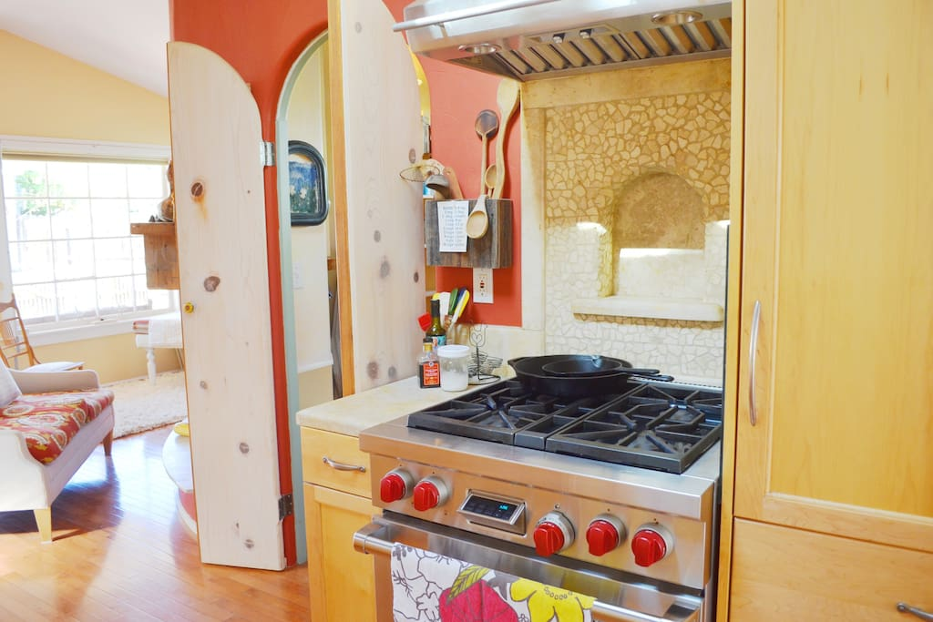 Kitchen altar - wolf stove, gas, oven is electric; refrigerator behind cabinet on right is a subzero