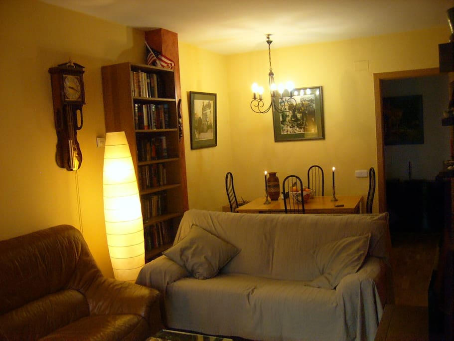 Other side of living room, into dining area, with door to foyer on the right