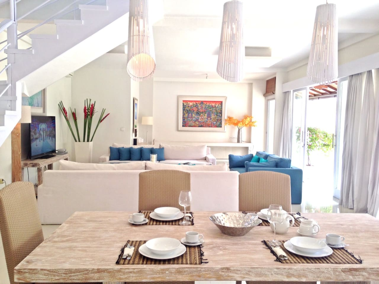 Airy living area overlooking the pool with modern decor and beautiful art works.
