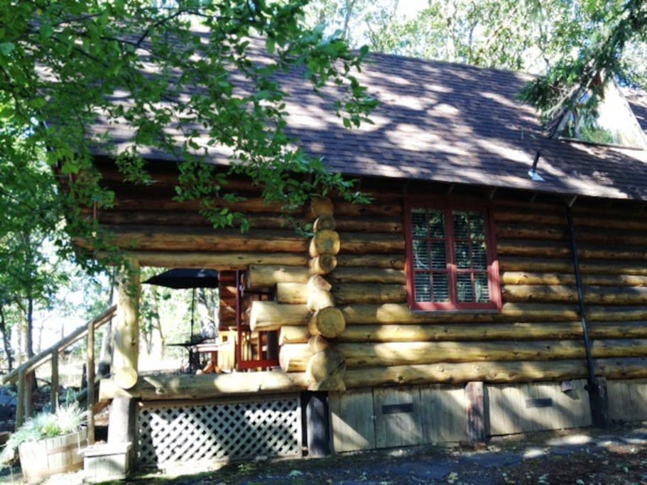 The Little Log Cabin is nestled in the trees in a private setting at the end of the road.