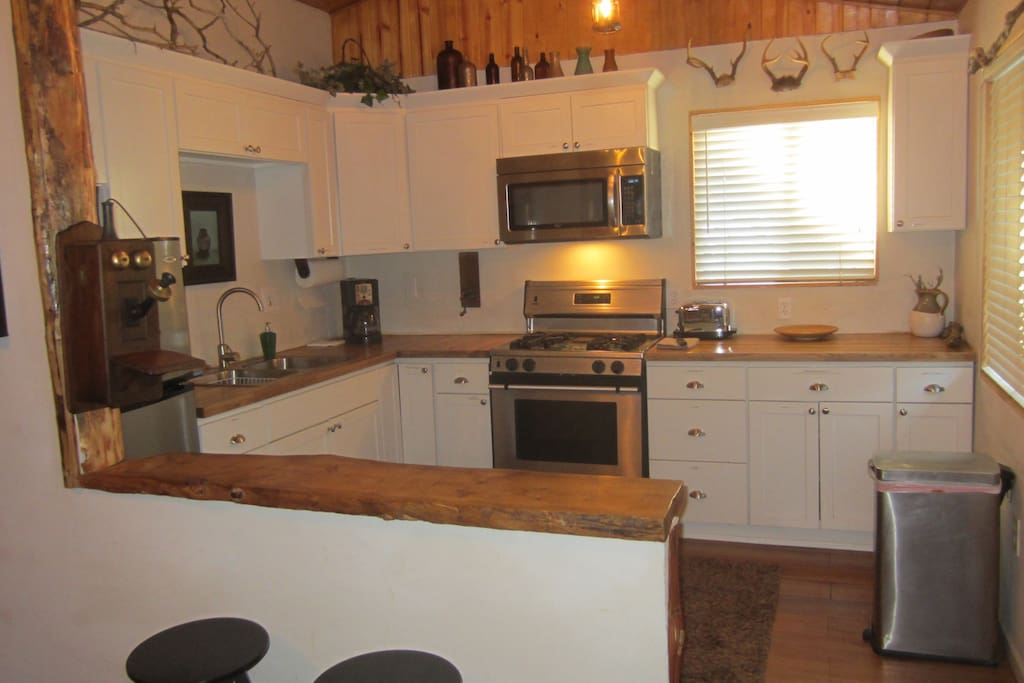 Remodeled chef's kitchen with all small appliances and spices w/four barstools and two tables for dining too