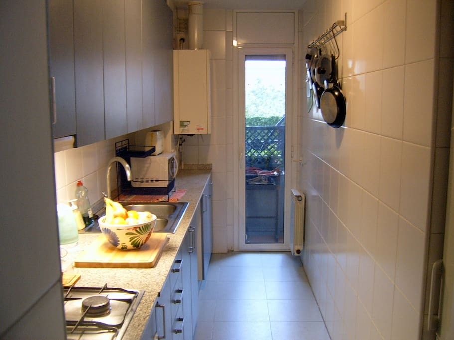Kitchen, taken from the foyer, door to the terrace in the background.