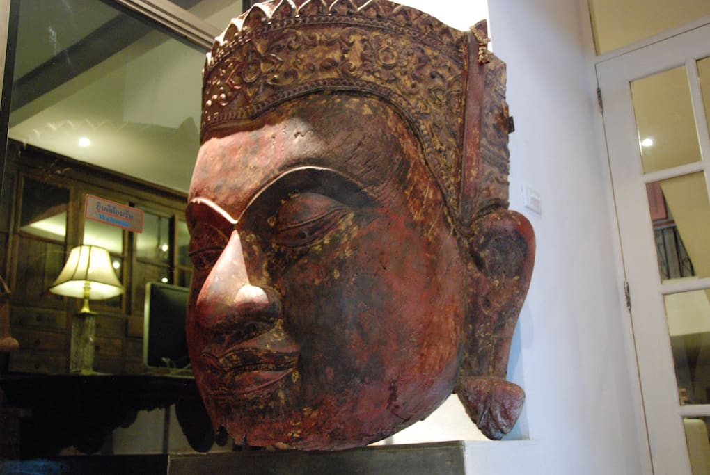 Ancient Khmer Buddha image at the entrance to Maison ice