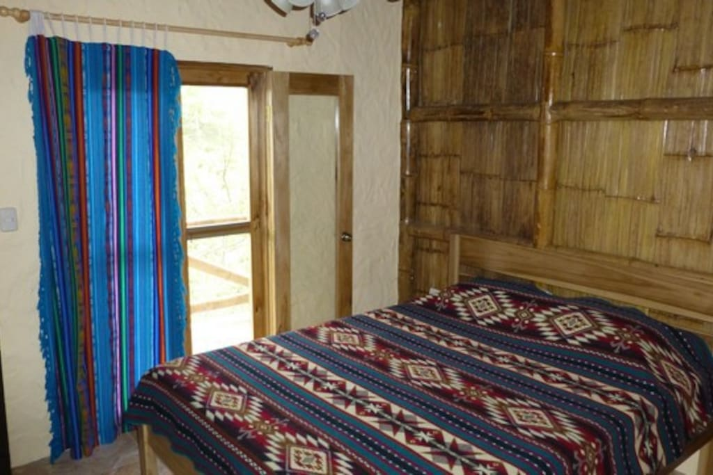 Comfortable Queen size bed and your own balcony overlooking the  lush Dos Mangas valley