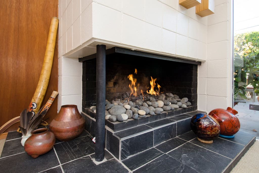 A gas fireplace warms the room up.