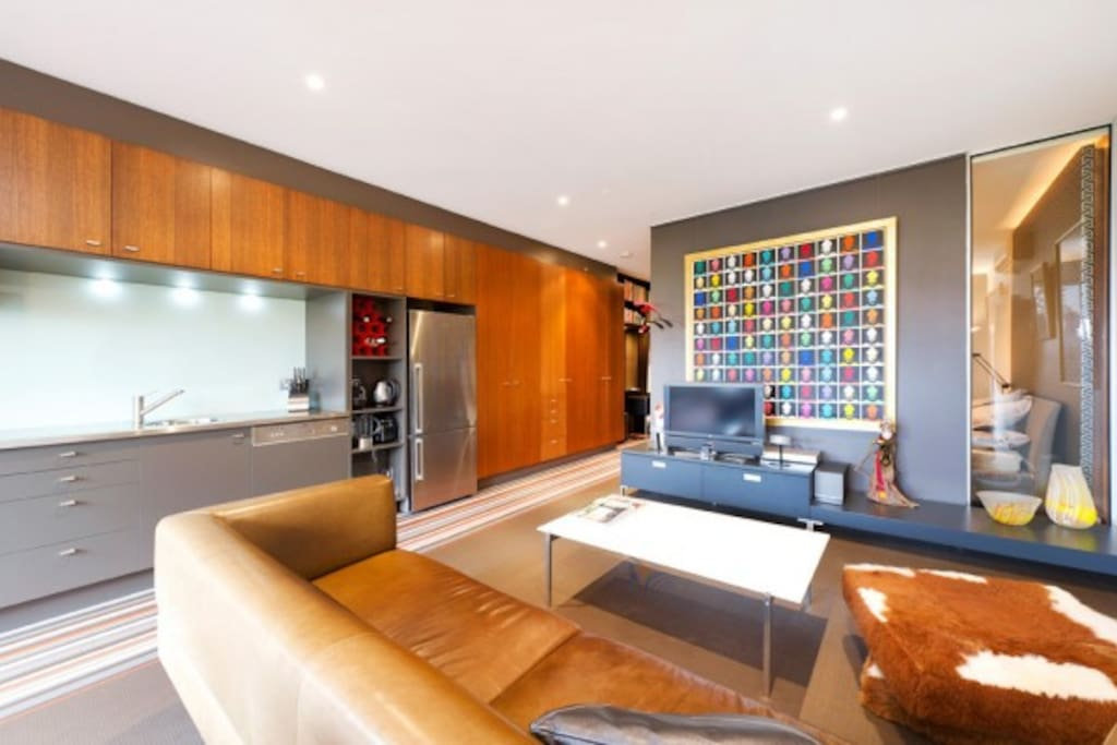 Open plan lounge with galley kitchen