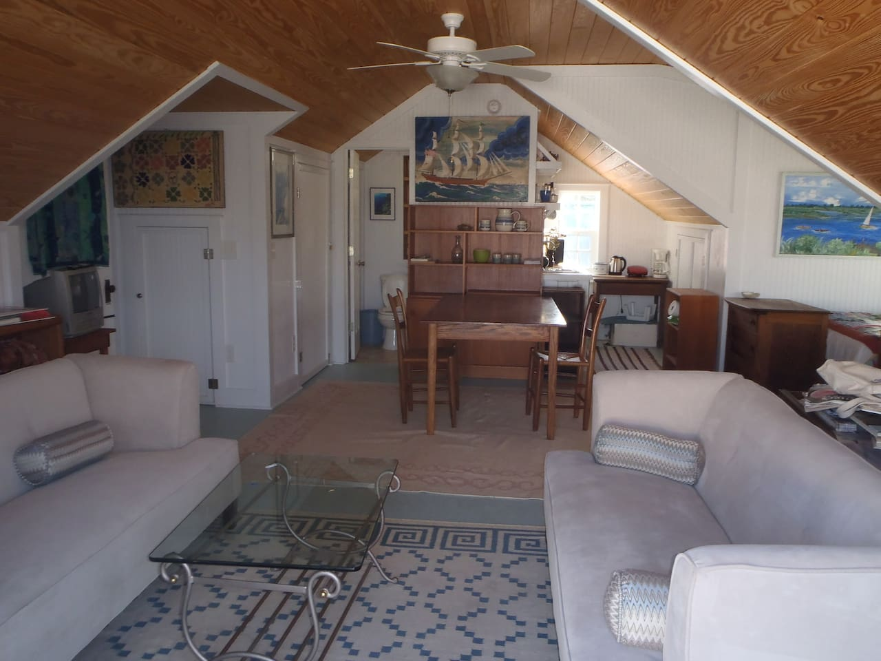 Great room has nautical theme: host is author/ editor, retired professor and sailboat captain. Lots of light: Sitting/ dining area, kitchenette alcove, small bathroom with shower.