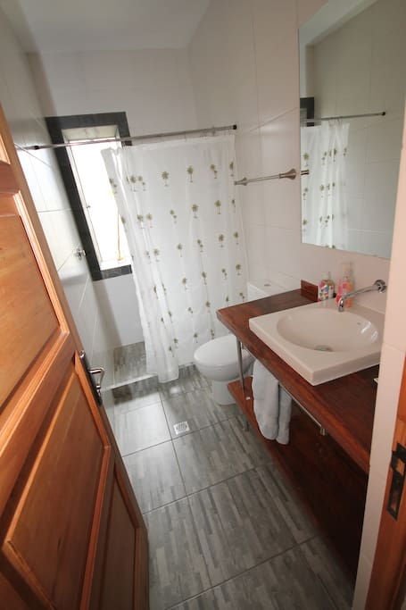 The guest bathroom has a gas heated shower and we provide towels, and soaps.