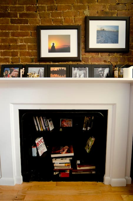 Exposed Brick wall with fireplace converted to libary