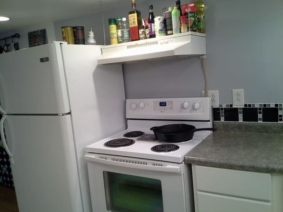 The kitchen, stocked with some basic items you need to cook