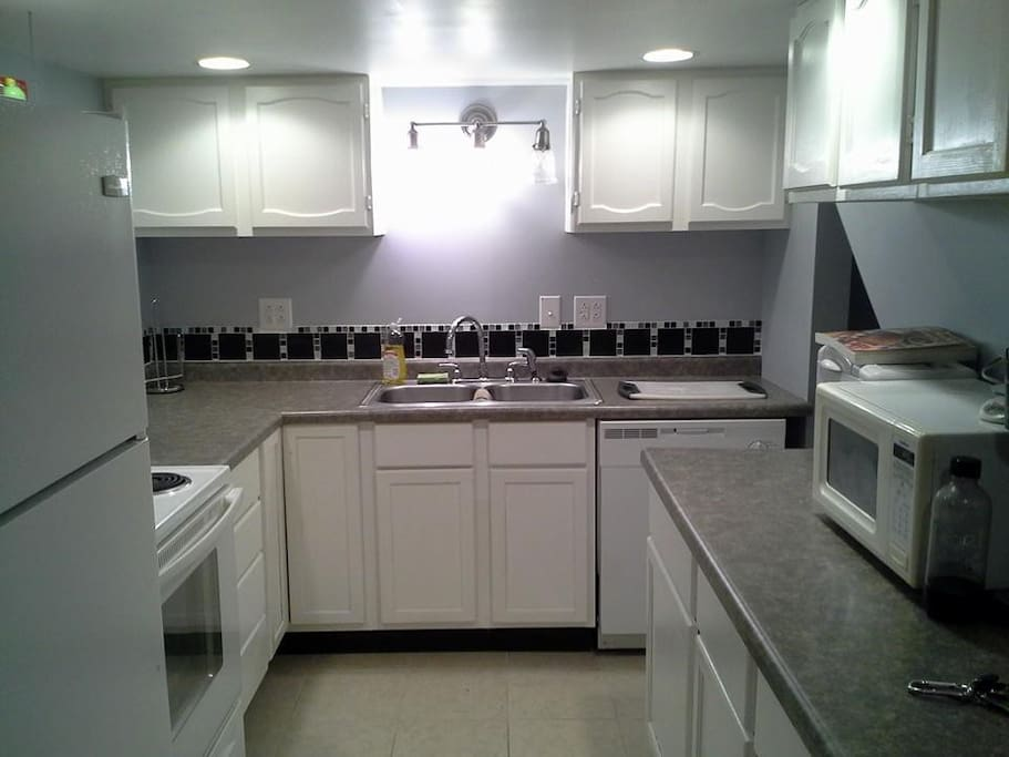 Cook your own meals in this fully-functioning kitchen with pots, pans, microwave, bread machine, etc.
