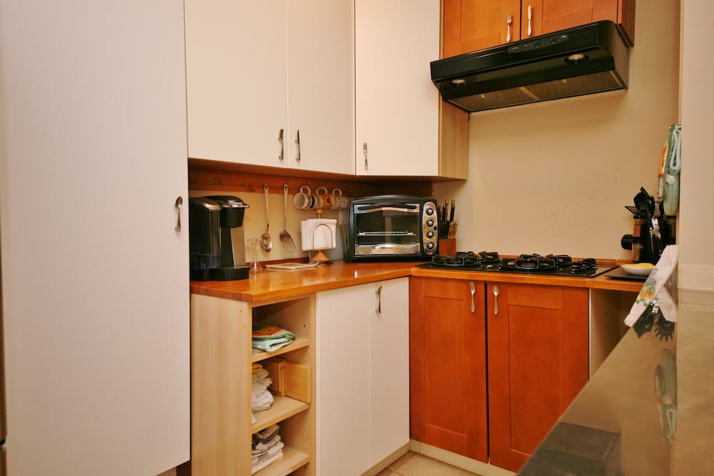 Cooktop, counter top oven, Keurig coffee maker, and all amenities.