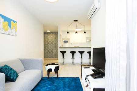 Nice 680 square feet apartment with 2 bedrooms, fully air-conditionated. Host up to 4 people, 2 in a double bed and 2 in another room in a bunk bed. Full kitchen, laundry, high speed internet connection,  swimming poll, sauna and hotel-like services.