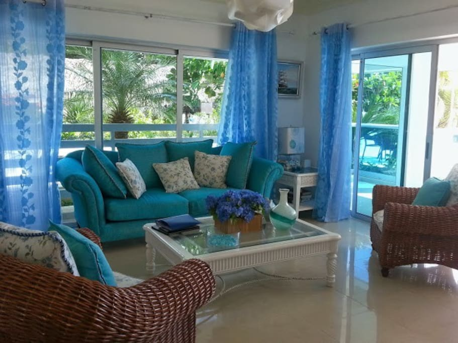 Share a glass of wine in the beautiful blue and white living room