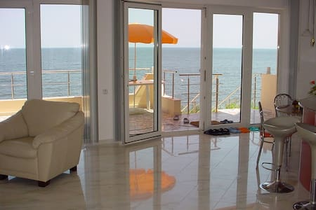 This amazing sea-front apartment in situated in a quiet area offering an unique panoramic view of the Black Sea and Eforie Resort and Marina. It is located within walking distance of city center, restaurants, beach bars and SPA facilities.