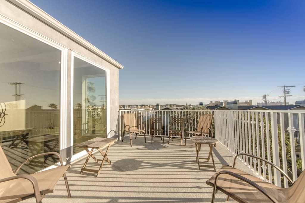 Third floor deck with beach view, blanketed with blue skies