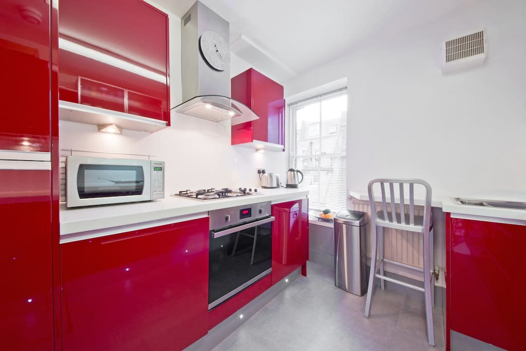Brand new designer kitchen with breakfast bar, fully stocked with all cooking essentials.