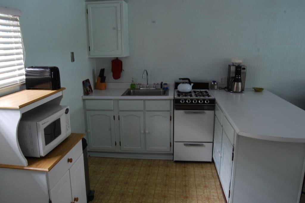 The kitchen has a microwave and a gas stove