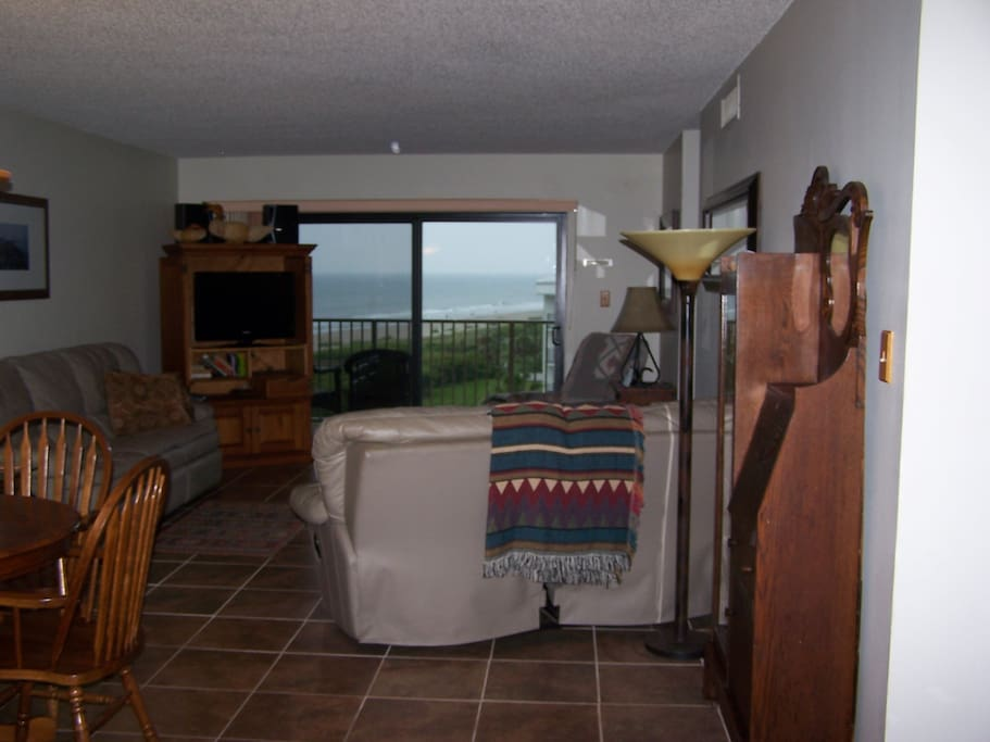 Enjoy view of ocean from the balcony and comfortable living room. All couches recline ahhhhh