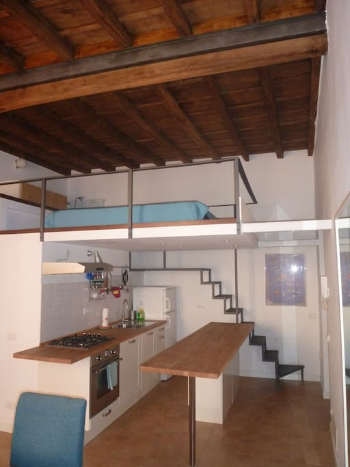 the loft design - high wooden beam ceilings