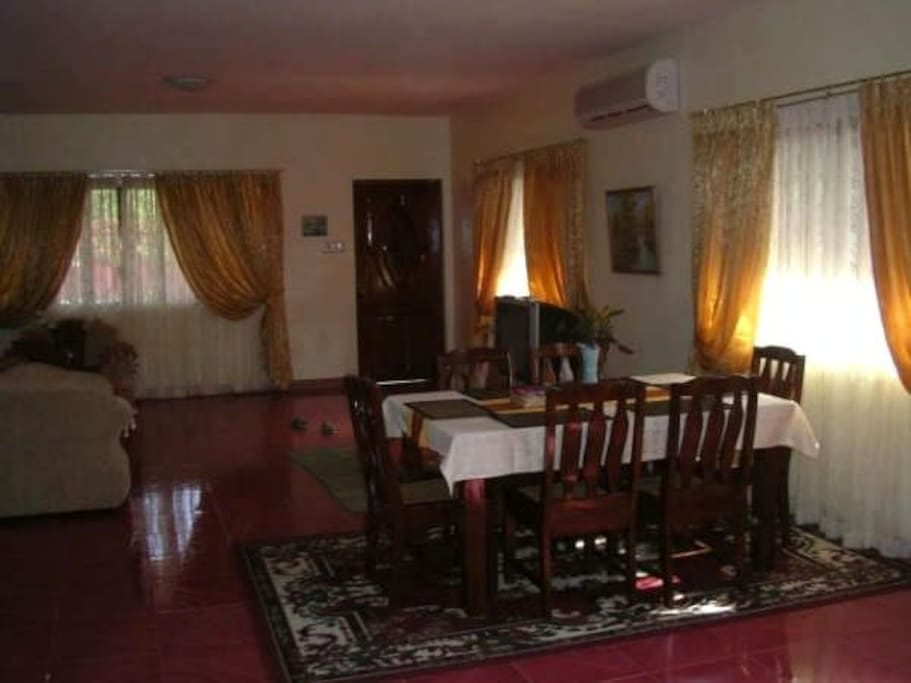 Part of spacious living room with dining table