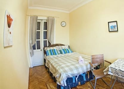 A bed in a cozy apartment - Saint Petersburg