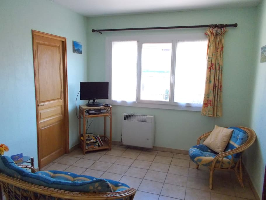 Relax in the comfortable lounge, with flat-screen tv and DVD player