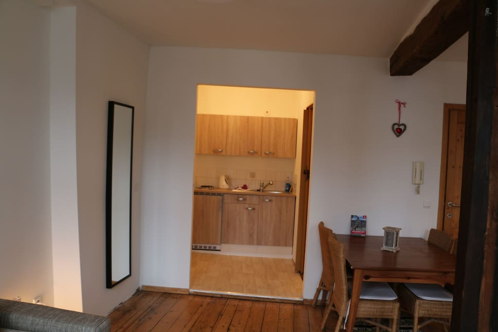 Open kitchen with a fridge, stove and basic kitchen equipment