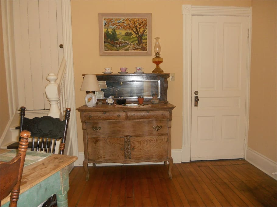 Dining Room buffet and stairs leading to 2nd floor bedrooms.Please sign our guest book on the buffet.
