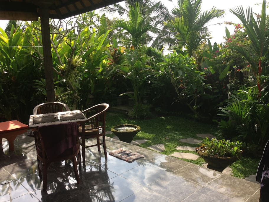 View of the lush gardens surrounding the villa, and the kitchen table. This is with the great morning sunlight.