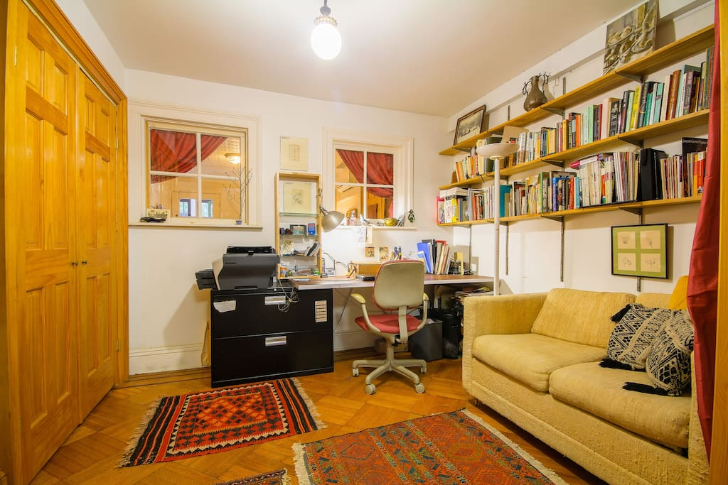 The study with a comfortable pull out couch for one, adjoins the front bedroom and is separated by french doors.  A third person can sleep here.