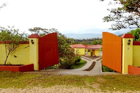 Located just outside San Vito your private paradise surrounded by jungle and pastured hills  imagine yourself sipping fresh local coffee as the sun rises.  The 64 ac finca (small farm) 500mt from the main road into town,  the bus stops at the corner every hour.  After passing thru the front gates your are in a garden of lush tropical  plants, exotic birds and butterflies.  The 250sq ft casita is well equipped for the adventurous guest, with two twin beds , writing desk , small kitchen and bathroom.   The large rancho has built in couches, outdoor sink, table and hooks for hammocks.  It is a great spot for morning exercises or just relaxing with a good book listening to the sounds of nature all around.  There are maintained trails in the jungle adjacent to the house and abundant banana trees as well as other fruit trees on the property.    At an elevation of 3000 ft the year round temp is 65-85 degrees making for a very comfortable climate.  The town of San Vito was established by Italian immigrants  and pizza is readily available in the many restaurants and bakeries in town.   San Vito is home to Wilson Botanical Gardens a research and bird watching center.  In less than 2 hours you can be at the beach or in the primary forest of La Amistad  where jaguars and quetzels can still be seen,  or you may  like to visit Panama.  Go to www.facebook.com/pages/Costa-Rica-SunRise/108387349190591 to view many more pictures and videos of the house, property and San Vito.