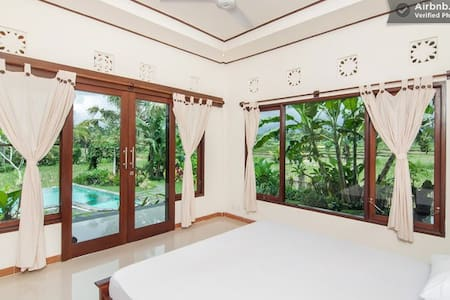 Wicked poolside room in peaceful home set in the rice fields. A very beautiful surrounding with some killer views of jungle and distant volcanoes. The home is brand new (just a couple of months old) and kept sparkling clean. Daily cleaning provided.
