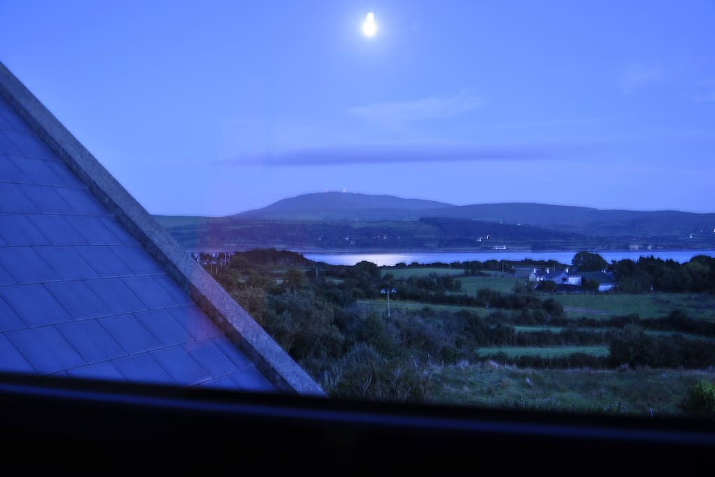Moon rising over the bay