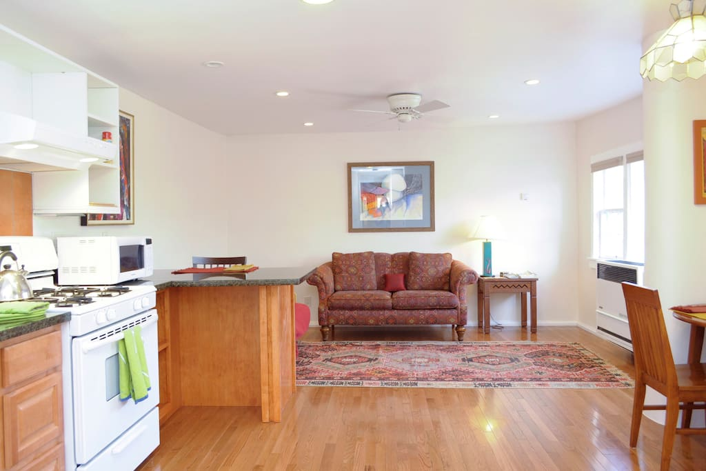 Wood floors throughout, but there's a thick carpet in the living room for yoga or any other floor exercises you like to do.