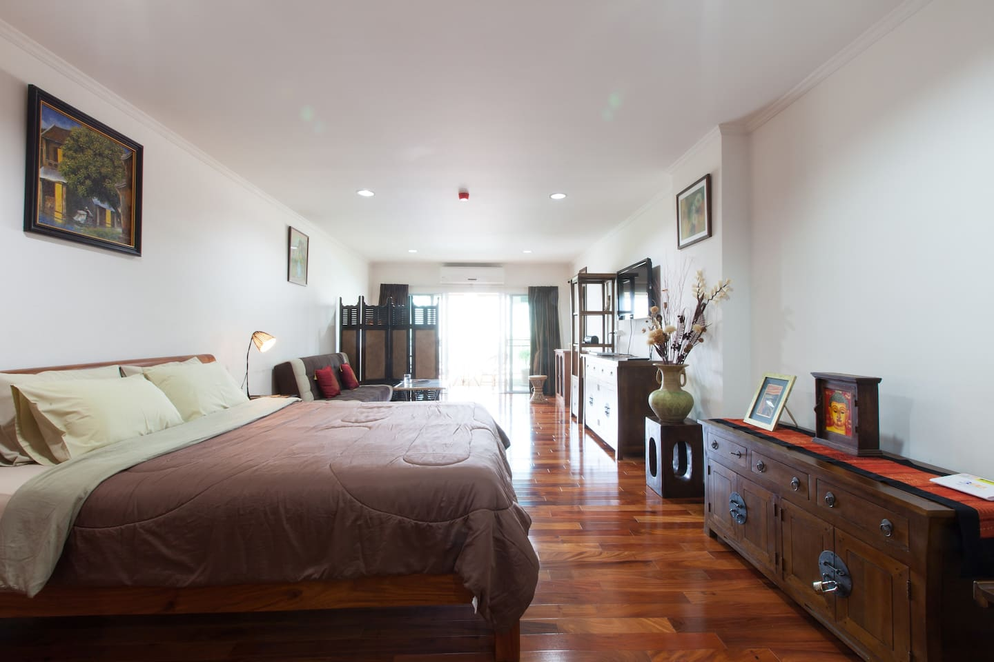 Spacious studio apartment with afternoon light from setting sun