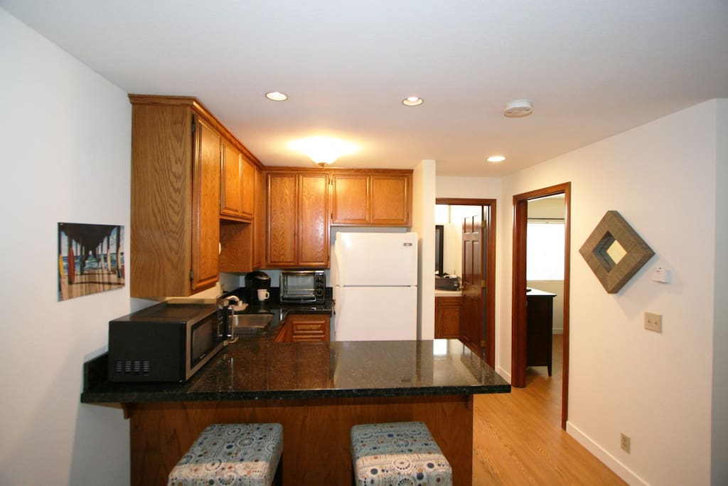 Small kitchen with refrigerator, microwave and coffee maker