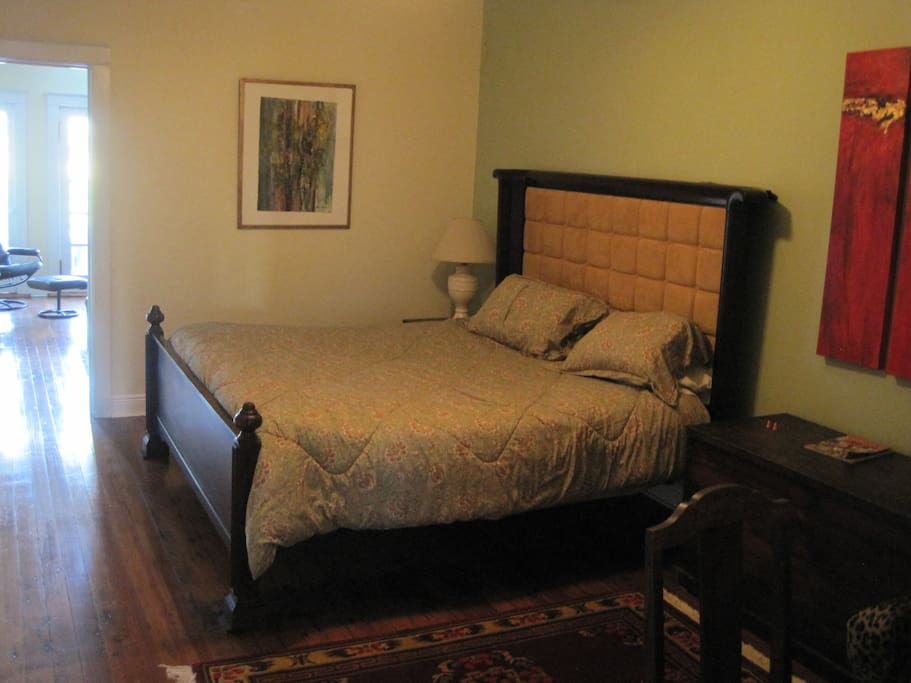 Master bedroom with brand new king-sized bed and a walk-in closet