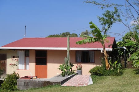 Furnished casita on large view property in the mountains above the town of Grecia.  Bus stops right at the driveway.  Enjoy lots of birds, butterflies, tropical gardens, and a wide variety of tropical fruit trees.