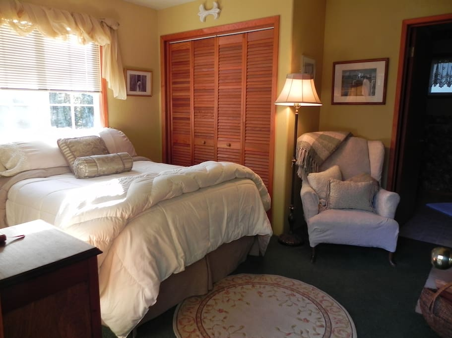 comfy room with sitting area.  Enjoy looking out the window at the stars on a clear night. There is nothing like it!