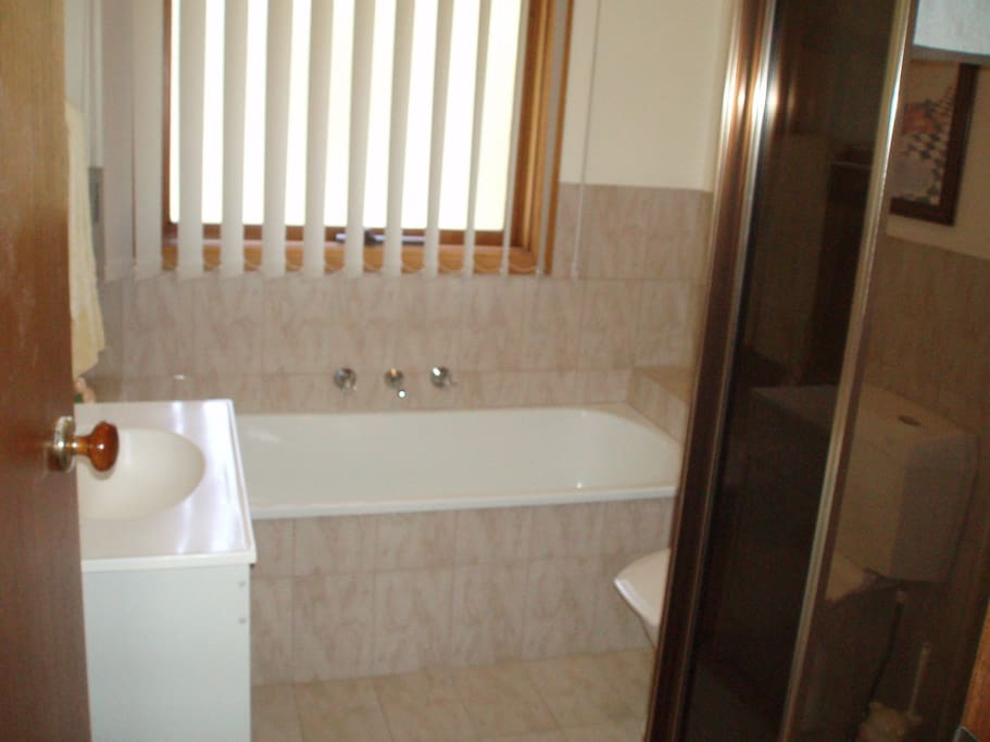 Family bathroom with separate shower, bath and toilet. Additional shower and toilet downstairs