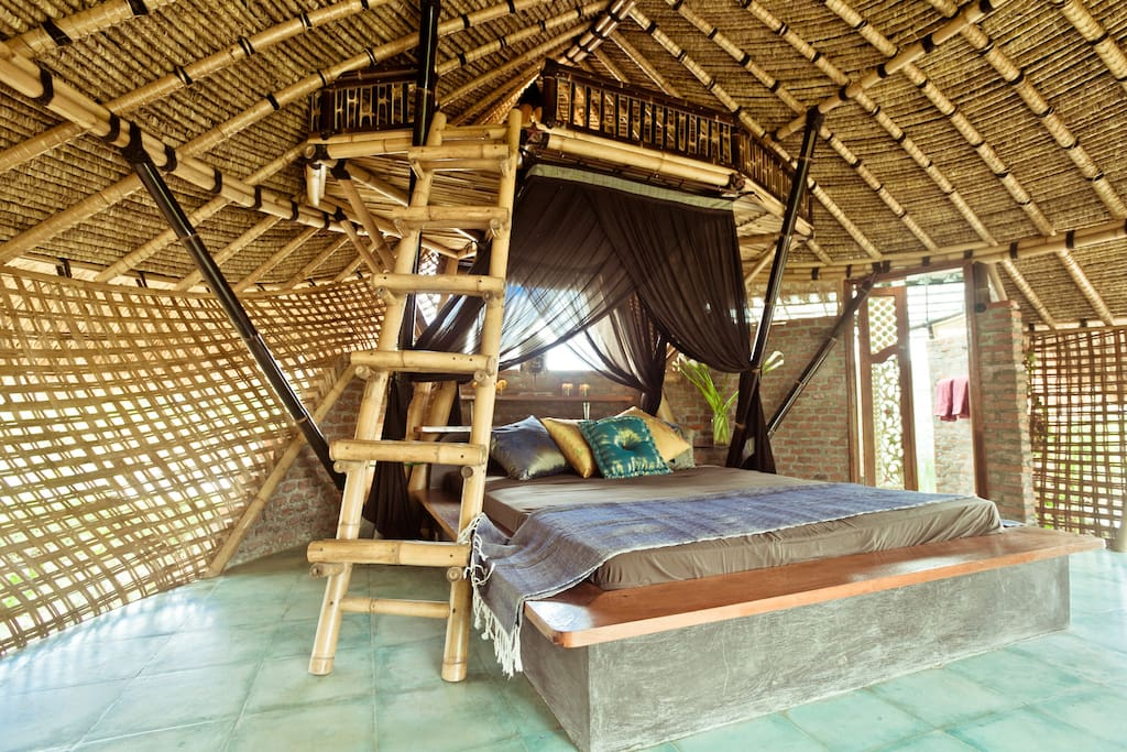 Bamboo eco cottage in rice fields